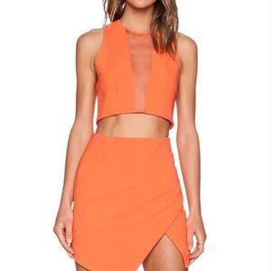Orange crop top with mesh. Matching skirt.